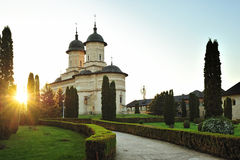 Christian monastery Cetatuia at sunset Royalty Free Stock Images