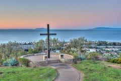 Christian monument against ocean backdrop. Stock Photo