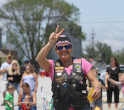 Christian Motorcycle Club lady in parade in small town America Stock Photos