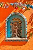 Christian Mural Motif on Orange Wall Royalty Free Stock Image