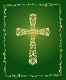 Christian ornate cross with floral gold pattern and vintage frame on green background. Christian ornate gold cross with floral gold pattern and vintage frame on Royalty Free Stock Images