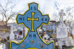 Christian Orthodox cemetery cross. Christian Orthodox blue cross in a cemetery with other crosses in the background Stock Photography