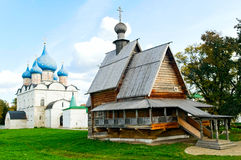 Christian orthodox churches. Cathedral of the Nativity and wooden church of St. Nicholas in Suzdal, Russia Royalty Free Stock Photos