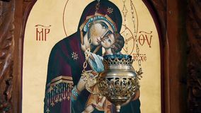 Christian Orthodox Icon Of Virgin Mary And child Jesus Christ. behind the candle