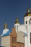 Christian orthodox white church with gold domes and crosses Stock Images