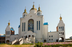 Christian orthodox white church with gold domes and crosses Royalty Free Stock Images