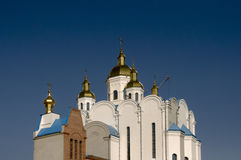 Christian orthodox white church with gold domes and crosses Stock Photo
