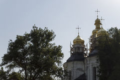 Christian orthodox white church with gold domes and crosses. Restoration Stock Photos