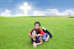 Christian parent and son play on the field Royalty Free Stock Photography