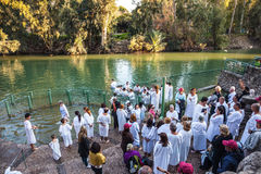 Christian pilgrims baptized dressed in white shirt Stock Photography