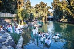 Christian pilgrims enter Jordan River waters Royalty Free Stock Images