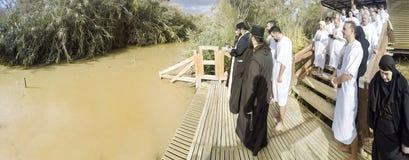 Christian pilgrims during mass baptism ceremony at the Jordan River Stock Image
