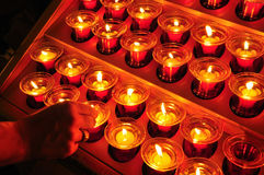 Christian prayer burning candle lights Stock Images