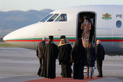Christian priests holy sacred fire. Sofia, Bulgaria - April 11, 2015: Christian priests are delivering the holy fire at Sofia airport. The sacred fire is taken royalty free stock photos