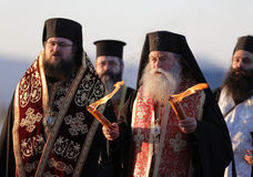 Christian priests holy sacred fire. Sofia, Bulgaria - April 11, 2015: Christian priests are delivering the holy fire at Sofia airport. The sacred fire is taken stock photography
