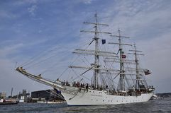 The Christian Radich leaving Amsterdam. Port Amsterdam, Amsterdam, the Netherlands - August 23, 2015: The Christian Radich tall ship (Norway) on the Ij river Royalty Free Stock Photography