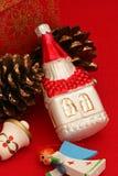 Christian Religious Christmas Ornaments. Christian-themed Christmas ornaments on red background Stock Photography