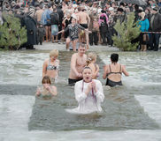 Christian religious festival Epiphany. People bathe in the river in winter. Stock Photos