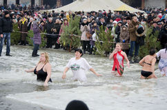Christian religious festival Epiphany. People bathe in the river in winter. Stock Photo