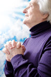 Christian religious senior woman praying Stock Photos