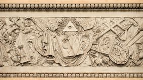Christian religious  symbols. Christian religious symbols with the eye of providence on a 19th century relief in Rome People`s Square Stock Image