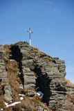 Christian rood on the summit of rock. In Carpathians Royalty Free Stock Image
