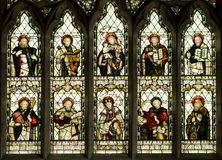 Christian Saints Stained Glass Church Window. Stained glass window showing ten Christian saints.  St Peters Church, Cound, Shropshire, England Stock Photos
