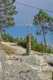 Christian sculpture , wood cross and stone in the base royalty free stock photos