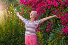Christian senior woman arms outstretched with praise. And joy royalty free stock photos