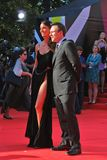 Christian Slater and Sofia Arzhakovskaya smile and pose for photos. Stock Photo