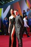 Christian Slater and Sofia Arzhakovskaya smile and pose for photos. Royalty Free Stock Photo