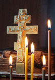 Christian still life with metal cross and burning candles Stock Photography