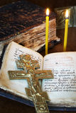 Christian still life with old metal crucifixion and book Royalty Free Stock Image