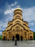 Christian stone Church with a gilded dome. Big christian stone Church with a columns and gilded dome in the city