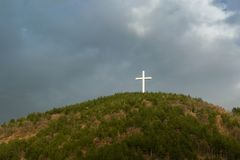 Christian symbol - The Jesus Cross - on the top of the hill royalty free stock image