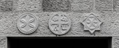 Symbols above the doors. Christian symbols above the doors Stock Image