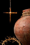 Christian symbols of easter. Antique wine jug and an easter cross made of rusty nails symbols of the resurrection royalty free stock photography