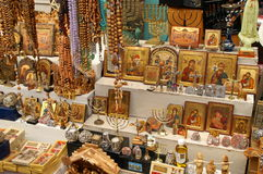 Christian symbols in the Jerusalem east market. Christian symbols - cross, jesus, icon in the Jerusalem old city east market before Christmas Stock Images
