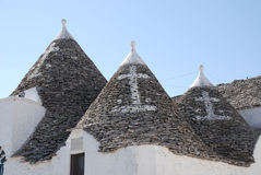 Christian Symbols on Trulli Roofs. The roofs of trulli in Alberobello, southern Italy - a UNESCO World Heritage site. On the roofs are the Christian symbols for Royalty Free Stock Photo