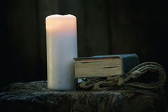 Christian Symbols. Wit Candle and Bible Book Stock Photography