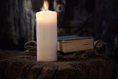 Christian Symbols. Wit Candle and Bible Book Stock Images