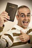Christian Vintage. Vintage Portrait of a very happy Christian holding his Holy Bible Royalty Free Stock Images