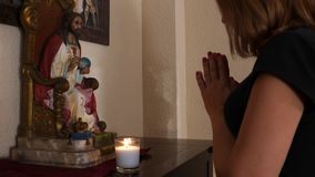 Christian woman doing daily prayers stock video footage
