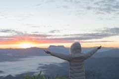 Christian woman hands praying to god on the mountain background with morning sunrise. Woman Pray for god blessing to wishing have. A better life. Christian life royalty free stock image