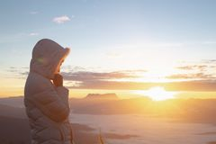 Christian woman hands praying to god on the mountain background with morning sunrise. Woman Pray for god blessing to wishing have. A better life. Christian life stock photography