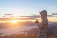 Christian woman hands praying to god on the mountain background with morning sunrise. Woman Pray for god blessing to wishing have. A better life. Christian life royalty free stock photography