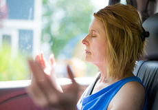 Christian Woman Praying with Arms Raised royalty free stock photography