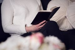 Christian woman reading the Bible Royalty Free Stock Photos