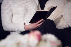 Christian woman reading the Bible Royalty Free Stock Photos