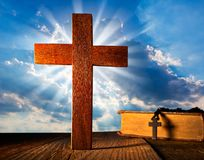 Christian wood cross on blue sky. Wooden made with Bible and rosary beads royalty free stock images